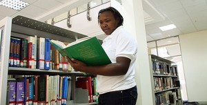 A student at the USIU university at the library