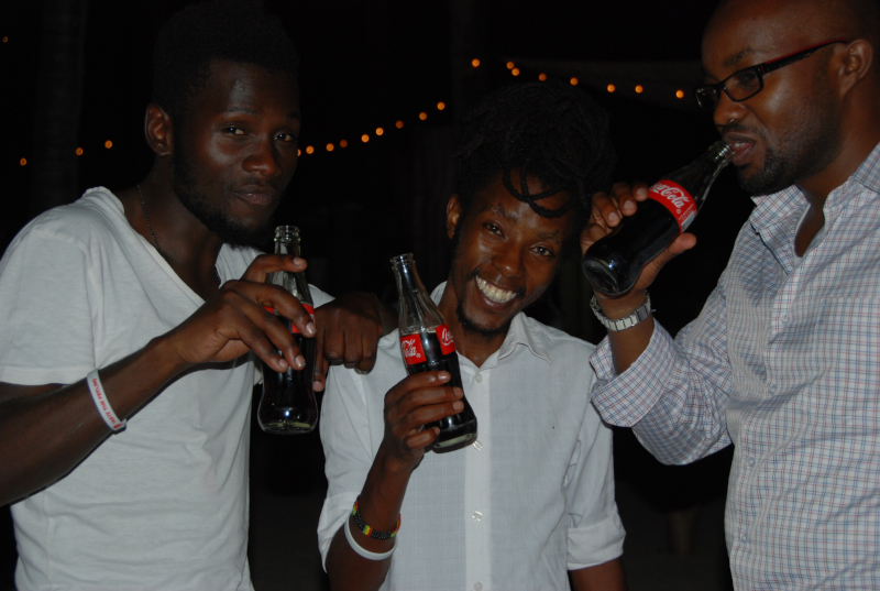 Vincent Omondi, Mbusi and Elly Gitau at the all white themed party at Vipingo Private Beach during Coca-Cola's Taste The Feeling launch