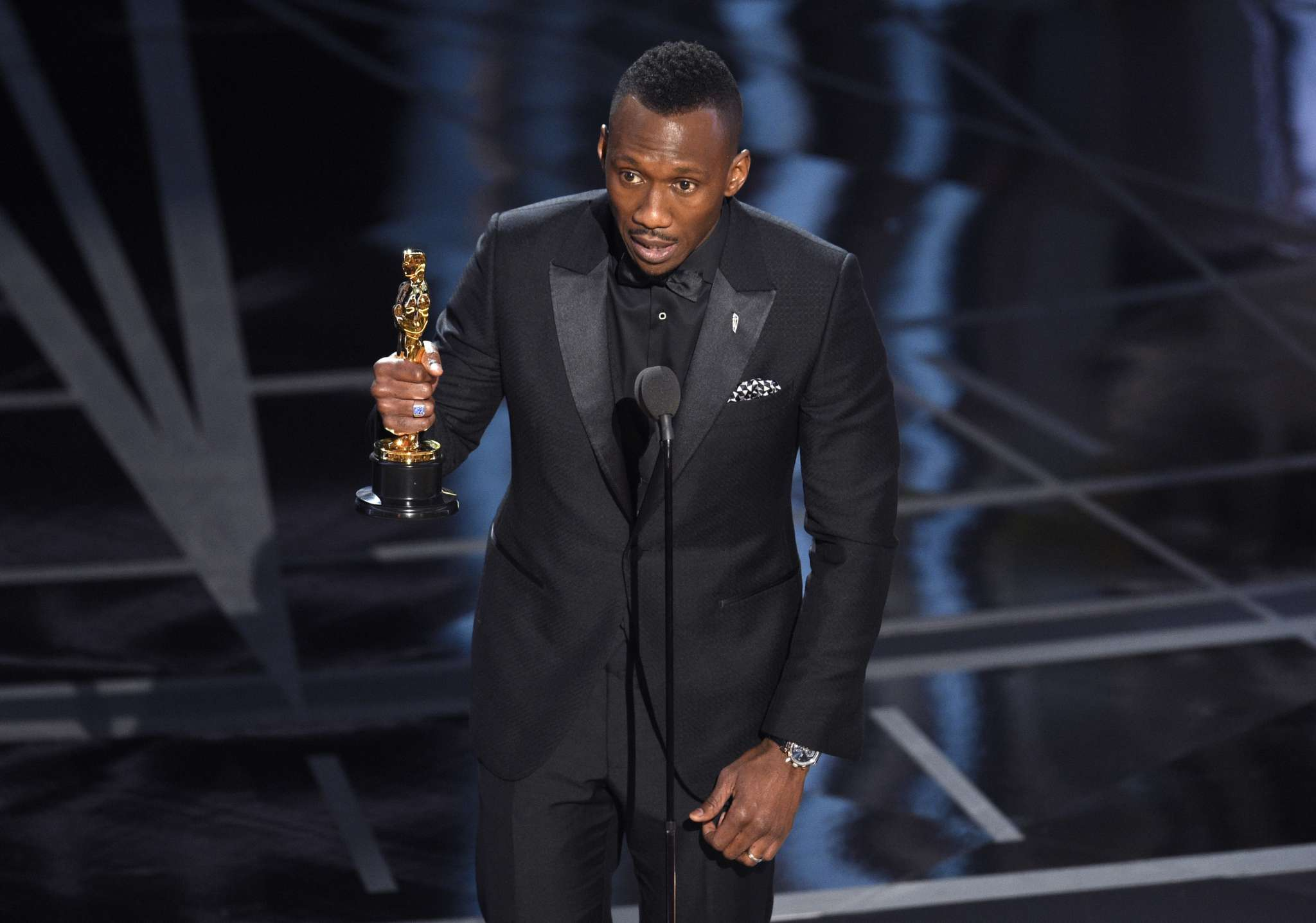 "Mahershala Ali accepts the award for best actor in a supporting role for ""Moonlight"" at the Oscars on Sunday, Feb. 26, 2017, at the Dolby Theatre in Los Angeles."